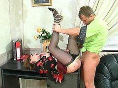 Freaky business-woman in barely darksome pantyhose fucking and working at one time