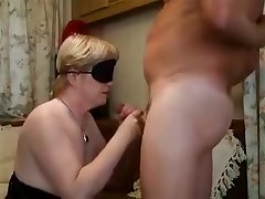 Blonde lady with a blindfold is forced to feel her way to a hard boner previous to putting it in her mouth. The epic blowjob gets a little too hot and that babe need to take a break with a hand job in betwixt the deep throats.