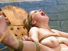 Her moaning and screaming won't help this bitch to much. The executor craves to make her pussy wet even if it means to spank and use water jets on it. She is tied with her sexy legs spread and her pink, bald vagina is at fully display. Perhaps this babe will squirt if the man keeps it up that way