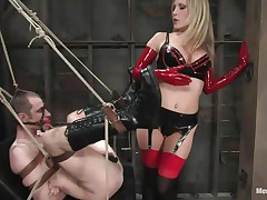 Watch this super sexy blonde mommy teaching this bad boy a lesson in hard way. This babe tied him up and gagged his face hole before fucking his world upside down! This babe puts on a strap on and fucks him real hard. This babe also locked his cock so that this guy can't cum! This babe keeps teasing his cock and fucking his wazoo with pleasure!