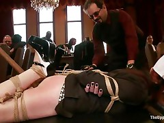 Slave gal is bound on the table at a sex party, during the time that the other people are taking advantage of her and laughing. That babe has dildos in both her dirty throat and filthy cunt. The whore is very thankful for this treatment and enjoys having her ass spanked by other horny whore at the same time. Check this out!