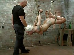 I bet u love seeing a cute golden-haired slut getting what that babe deserves. If u do then see this tied up angel that is hanging there getting punished for being such a bad girl. Her pretty face begs for mercy but that babe ain't going to acquire any, instead that babe will acquire a nice big cock in her sweet mouth. This babe sucks that dick and starts to enjoy it a lot, maybe pain is fun to her when that babe gets fucked.