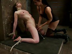 This is hawt and only gets better, a dominating milf wearing stockings and sexy raiment is showing a younger gal who's the boss. She ties her with rope and as the rope goes throughout those her pussy lips, a weight at the end of the rope makes things more interesting. The chick is suffocated too and probably she enjoys it a lot!