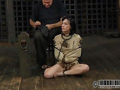 Sexy brunette Elise is all fastened up and shackled and sits obedient on the floor near to her executor who puts a mask on her face. This guy explains this s&m technique and what this babe is supposed to do. The bitch enjoys being the center of attention and waits for her thraldom treatment. Wanna see what happens to her?