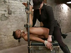 With her feet fastened up and metal clamps all over her body the ebony slut endures a harsh punishment. This bitch goddess knows what he's doing and gives her both ache and pleasure. She can't even scream as her throat is folded with scotch tape. Look at that bald cunt and how deep she's rubbing it with the vibrator.