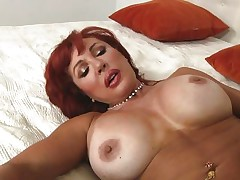 Her years of experience in fucking have a lot to say. Check out this gorgeous redhead milf and how lustfully this babe sucks and bonks cock. Damn the bitch knows how to drink a cock and when this babe goes on top and rides this guy we can clearly see her pussy lips spreading. Yep this milf needs some jizz unfathomable inside her