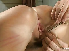 Her executor has a lot of experience when it's about naughty vaginas like her. He shows where her place is and after this chab tied her on the table this chab gapes her cunt securing it with laundry pliers and rope. After her bawdy cleft is gaped this chab spanks her and humiliates her pussy just the way it deserves. Wonder what else this chab has in mind?