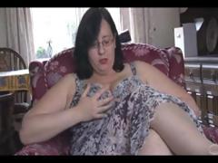 Fat mature brunette with huge scoops and ass sticks dildo in her pussy