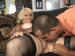Mature blonde Sophie Mounds with moist pierced snatch