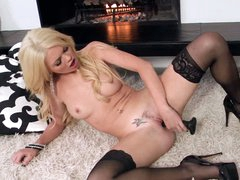 Alexis Ford takes black toy by the fireplace