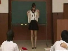 Japanese teacher reluctantly disrobes in nature's garb in front of students