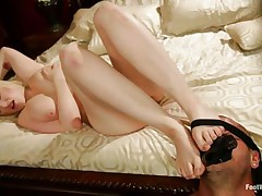 Siri is a pretty golden-haired with big natural breasts, milky white skin, red bewitching lips and a pair of hot legs. That babe is rubbing the guy's hard dick with her feet, gratifying him and he sucks her toe with gratitude. Her voluptuous body makes u wonder if he will cum on her, especially on these hot feet!