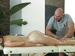 Look at this pretty brunette having a massage on her long sexy legs and her sexy body. Just at the view of her moistured ass and her tight cookie that babe gets the guy all horny and makes him want to give it to her deep. Do you think that babe needs some spunk with all that oil or a big hard cock in her cunt?
