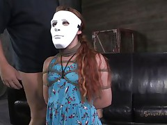 Hope Claire likes games coz she's part of one. The marvelous redhead wears a mask but not for long, pretty soon her mask is removed and she is knelt in front of her executor's cock. That guy grabs her by the head and starts mouth fucking this bitch hard and merciless. Is Claire going to gag with his semen?