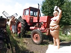 Melinda is so much woman she needs 2 men to fuck her. Tibor and Gabor lift up her chubby folds and widen her gazoo cheeks. The both suck on her huge melons outside by the tractor. The rubs every part of her big chubby beautiful body.