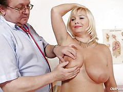 This blonde floozy is completely naked at the doctor. The doctor begins examining her large breasts with large and sexy nipples. After that that guy takes her pulse. The mature women is sitting on the bed now with her large a-hole at the doctor. That guy start inspects her a-hole and large shaved vagina from behind.