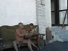 These two old farts where looking in a porn magazine when granny Heidrun caught them. As lengthy they were all there they've began fucking and formed a threesome. The granny was naked by the old guys and they've started to grope her boobs and massage her saggy cunt. Will they fill her with semen?