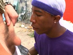 Interracial gay scene with white and black studs having fun