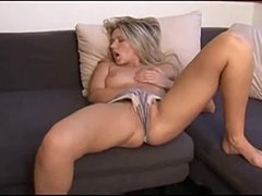 Blonde chick fingers lustily whilst on the couch