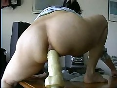 Watch this masked British play around on video with her boyfriend.  First this babe spreads her goods to show what this babe has to offer before this babe straddles a huge dildo up her ass.  Listen to her wince as this babe tries to get it up as far as this babe can take it up the pooper.  She's a real trooper as this babe does what her boyfriend tells her to do with the dildo.  Great way to train her for anal.