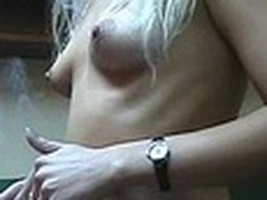 Lecherous blond sweetheart with small sticking tits walks naked in her room filmed by her boy-friend with dilettante cam in his hands. This guy doesn't like her smoking but really enjoys her hot nude body shyly covered by Fresh Year tree decoration :)