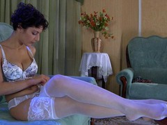 Bobbed black brown hair lovingly smoothing her luscious white lace top nylons