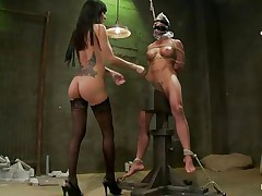 Gia DiMarco is a bad pussy, she enjoys punishing other sluts by whipping and suffocating them. Look at her all naked wearing no thing but a pair of high heels and black hose as she punish and dominates this milf, grabbing her by the nipps and pulling the rope around her neck. Her big boobs sexy legs and gorgeous gazoo is enough to make any guy want to be tied and punished by her.