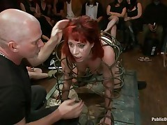They've putted her in a particular cage and as the bald man fucks her sexy mouth, 3 dirty strumpets are taking worthy care of her ass. She is fucked from one as well as the other ends and the sex toy and fingering she's getting on her arse only makes her face hole want to drink that dick as deep as she can while the public see her.