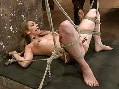 Take a look how hard her pussy is sucked! The golden-haired babe is about to receive a hard castigation from her experienced mistress. She hangs her upside down, removes the sucker and oils her pussy. After that the female-dom fingers deeply the blonde's fur pie and makes her scream insanely and almost to cum!