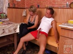 Mature mother and the Son&,#039,s ally have a worthy time on kitchen.
