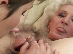 Sexy brunette grinds dripping bawdy cleft on old ladies face