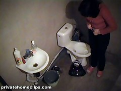Salacious brunette gadget used her time in the shitter to look in the pocket-glass. This babe urinated while checking her make-up and then put on her beige panty and jeans and got out of the room having no idea this babe was filmed!