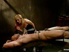 Dominatrix Lea enjoys playing with electricity and muscled guys. She takes her job very seriously and punishes her fellow like a real dominatrix. Her blonde hair, lascivious face and those sexy legs under her white pantyhose can make a fellow horny, especially when he's all fastened up and with electrodes on his body.