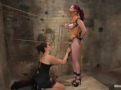That babe was a very bad milf, that babe dominated and drilled a lot of cuties and now it's time for her to be disciplined. Her pussy is beginning to get truly soaked because the brunette domina tied her, added clamps on her nipps and pulled them hard. That babe is immobilized and now has to suffer until that babe will become an unrepining slut.