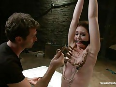 James is sick and tired of her attitude and decides to dominate her. After adding some more clothespins on her thin white body he sticks his rod between her wet lips and the way she's sucking it makes him ease her torment and removes a few pliers, will this babe be a good gal from now on?