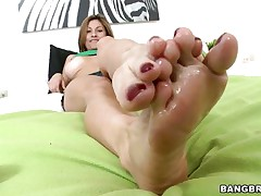 Lisa X is one fine woman from head to toe. Charming Eyes, sweet big tits, lean legs, a nice, round ass, and one yummy-looking pussy! The star this day is her feet, however, and she's getting 'em lubed up to take a cock between 'em and make her dude cum! If she's this good with her feet, then....
