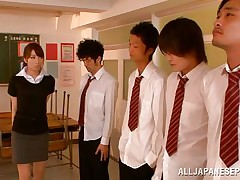 Arisu desires discipline and that babe aligns her students in order and then kneels to suck each and each one. The boys broke the line and surrounded her so now that babe has all those hard dongs around her pretty face. Can that babe handle all those knobs and will they repay their teacher with a few loads of cum on her face?