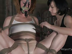 This is how these girls like to play. Cici is all tied up and has a mask on her face while her brunette angel takes advantage of her body. That babe squeezes her nipples and tongue and then begins rubbing that lovely cum-hole with a vibrator.