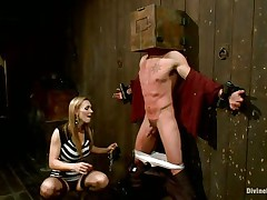 Blonde milf Tanya enjoys being Casey`s mistress and plays hard with his balls. This guy has his hands tied up to the wall with a box on his head. This babe can't live without torturing his nipples and making him feel like the thrall this chab is. Casey was a bad chap and now this chab must get the right punishment! Watch how his balls tremble.