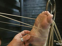 Melody Jordan is all tied up at the moment. She's getting screwed with one leg in the air and enjoying it too much, till a rubber band snap on the foot brings her back to earth. The position switches and now she's bent over with one leg in the air. The guy fingers and fucks her. This hottie says thank you sir.