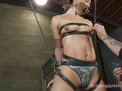 What do we have here? It's a slut, all fastened up in leather belt and hangs there waiting to be punished. She was a very bad gal and her torment needs to be hard! Wenona has her face hole gagged and the executor rubs her twat with a vibrator. Let's see if this guy has something to stick it in her ass