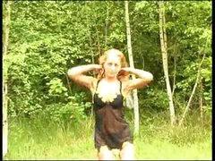 Blonde chick stripping outdoor