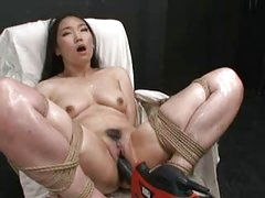 Hot Asian girl bound and drilled with fucking machine