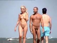 Nude couple filmed walking along the beach, priceless blonde with cute tits and shaved pussy.