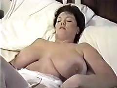 This homemade movie is a mix of hot movie scenes I have taken of my huge-titted wife. You can watch her strip, give me blowjob, shave her cunt, masturbate during the time that I fuck her, play with sex toys and take a bath.