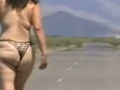 Out in the open desert walking in the centre of a highway with only a g-string covering her large wazoo body. In this public sex video u can see this aged bitch walk in nature's garb out in the open and flaunt her large fucking ass.