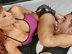Devon, a MMA fighter with a background in stand-up fighting, enlists the help of Charles, who teaches her the finer points of wrestling on her back.