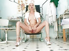 Cuz she is all alone in the office and has no thing to do, this gilf nurse gets lascivious and begins playing with her cunt. She takes a sit and spreads her long legs and then her love tunnel lips. Look at that tight pink cunt, would you like to watch some sexy cream on it? Well, if she's going to be even greater amount nasty maybe she will get some