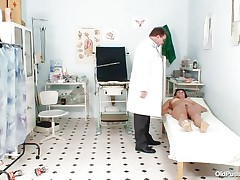 Naked Mature lady with large tits visits the doctor for her pussy examination. That playgirl is ordered to lay on the patient's bed doctor examines her stomach and then wears his gloves and tells her to spread her legs so that her cunt can be tested. Doctor examines it and then checks her wazoo and ask her if that playgirl had anal sex ever that playgirl replied with no.
