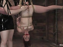 Claire Adams has Trinity Post's vagina wired. She's not merely tied up but upside down, and gagged to boot. She's got a metal plug in her cunt and Claire's using a vibrator on her clit, making her want to cum. This babe gets permission to cum and that babe does several times, moaning loudly throughout her ball gag.
